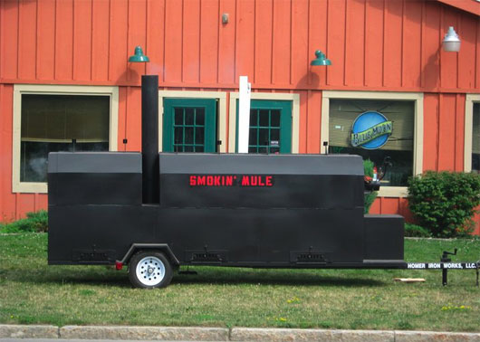 Big trailer rig outside Smokin' Mule in Cortland, NY