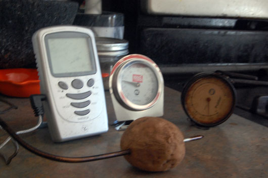 Three Thermometers in Question: a fancy digital probe, an old-fashioned oven model, and a grill model